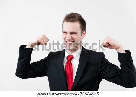 a portrait of young businessman showing his muscle