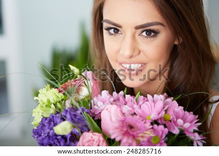 a portrait of young woman with flowers - stock photo