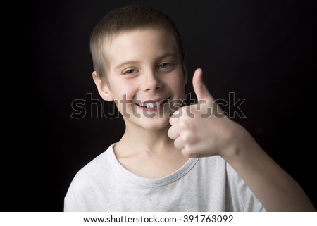 A Portrait smiling boy of eight years.  - stock photo