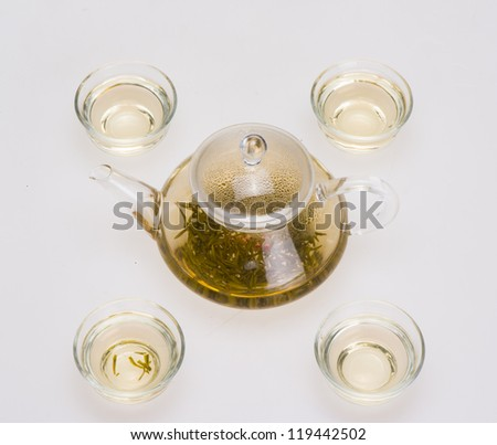 a pot of tea with cup