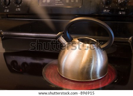 a pot warming water - stock photo