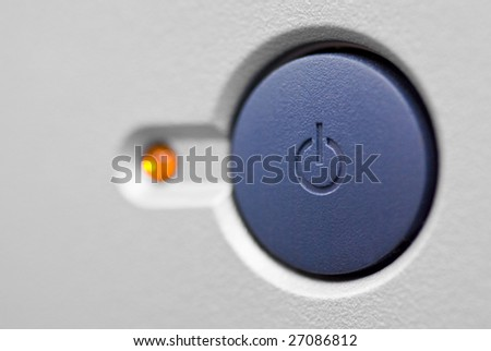 A power button on a computer in standby mode - stock photo