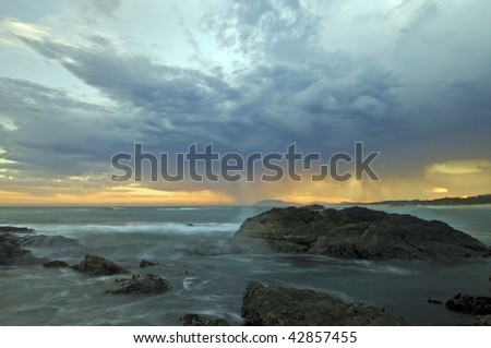 A powerful cloud formation over a beach - stock photo