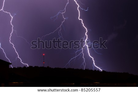A powerful thunderstorm produced a vivid and close lightning strike.