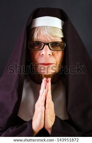A praying nun - stock photo