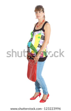 A pregnant woman (9 months) with a red bag - stock photo