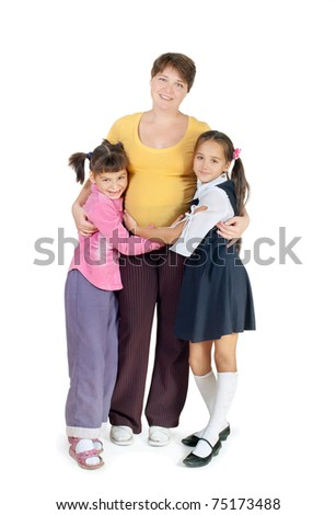 A pregnant woman with two daughters. White background