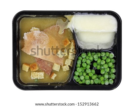 A prepared frozen meal in a black, plastic tray. - stock photo