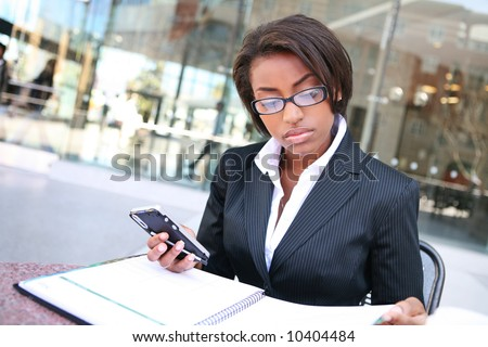A pretty african american business woman at her company - stock photo