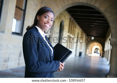 A pretty african american woman at college - stock photo