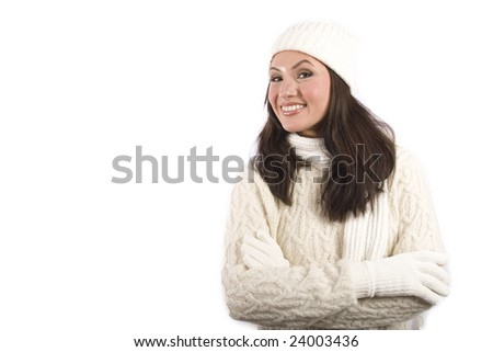 A pretty asian woman poses with winter clothes