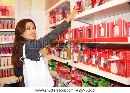 A pretty asian woman shopping for the holidays