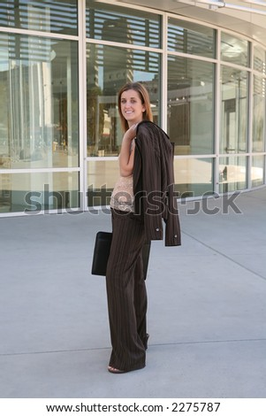 A pretty business woman on her way to the office - stock photo