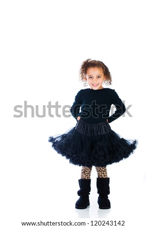 A pretty child wearing a black dress. - stock photo