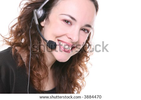 A pretty customer service woman with headphone - stock photo