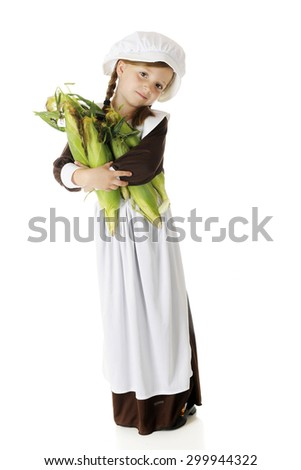 A pretty elementary Pilgrim carrying an armload of fresh corn.  On a white background. - stock photo