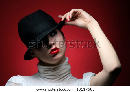 a pretty fashionable girl with retro hat - stock photo