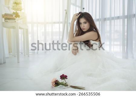 A pretty girl in a beautiful wedding dress - stock photo