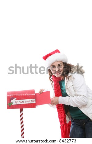 A pretty girl mailing her letter to santa claus at Christmas - stock photo