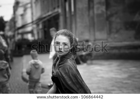a pretty girl walking on the streets - stock photo