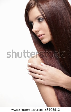 A pretty girl with long hair isolated - stock photo