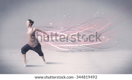 A pretty hip hop dancer dancing contemporary dance illustrated with glowing motion lines in the background concept. - stock photo