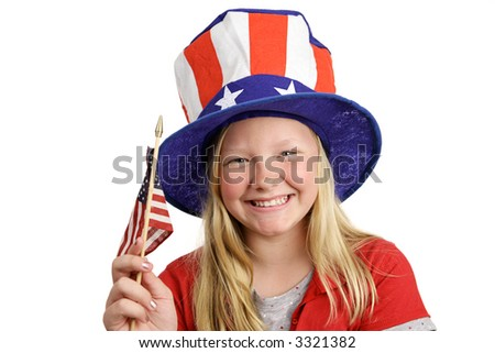 A pretty little girl in a patriotic hat waving an American flag.  Isolated on white.