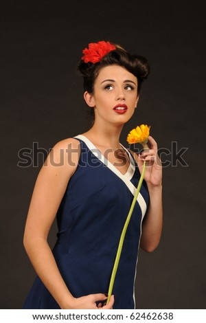 A pretty pin up girl in a sailor dress. - stock photo