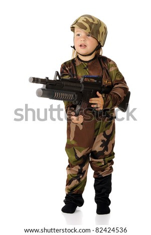 A pretty preschooler in soldier garb standing at the ready with a toy machine gun.  Isolated. - stock photo