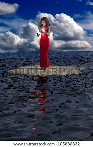 A pretty redhead gazes into a magical glowing sphere while perched on an ornate platform surrounded by water - stock photo