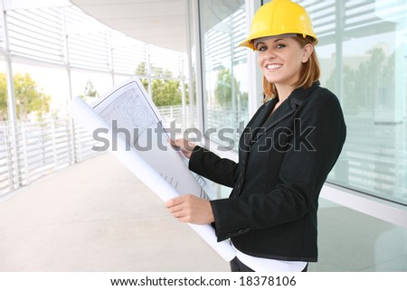 A pretty woman architect on the building construction site