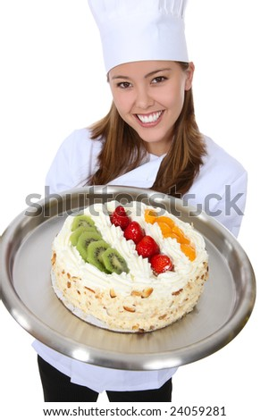A pretty woman chef holding a dessert cake isolated over white