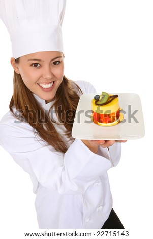 A pretty woman chef holding a dessert isolated over white - stock photo