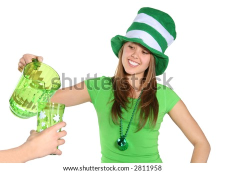 A pretty woman dressed in green and pouring a drink at a saint patricks day celebration