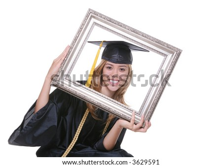 A pretty woman graduating holding a picture frame - stock photo