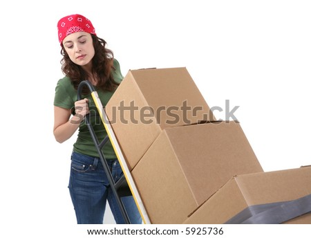 A pretty woman moving and shipping using a two wheel push cart