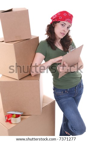 A pretty woman packing her shipment and making plans - stock photo
