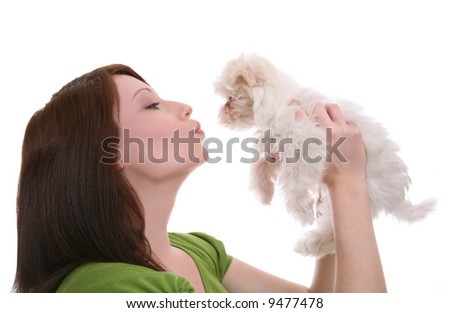 A pretty woman showing love (kissing) to her dog - stock photo