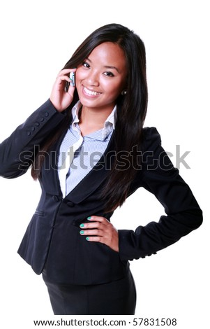 A pretty young asian businesswoman on the cellphone isolated on white - stock photo