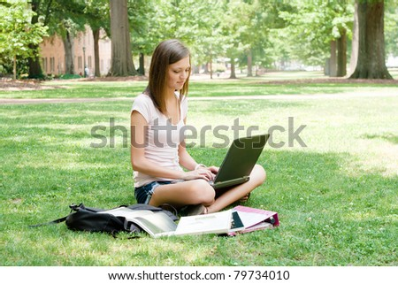 A pretty young college or high school age girl with study materials