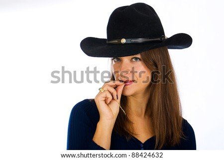 A pretty young country girl wearing a cowboy hat.