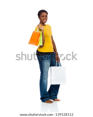 A pretty young lady with shopping bags on a white background - stock photo