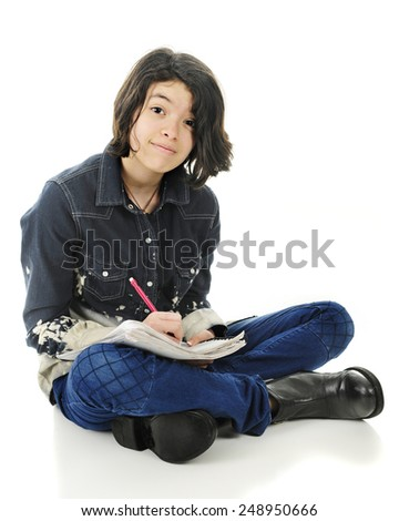 A pretty young teen happily looking at the viewer while sitting cross legged on the floor with pencil and note pad.  On a white background. - stock photo