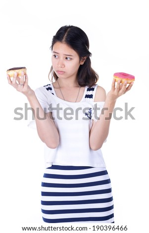A pretty young woman about to eat a donut (on white background)