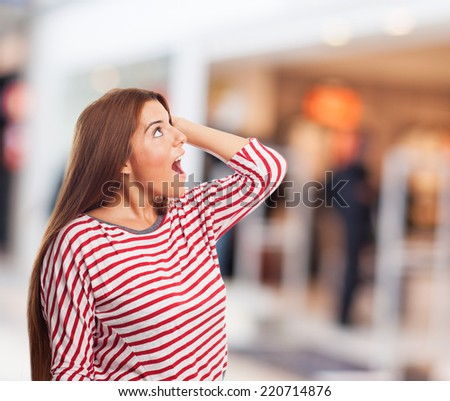 a pretty young woman amazed looking up - stock photo