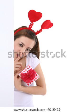 A pretty young woman holding Valentines presents