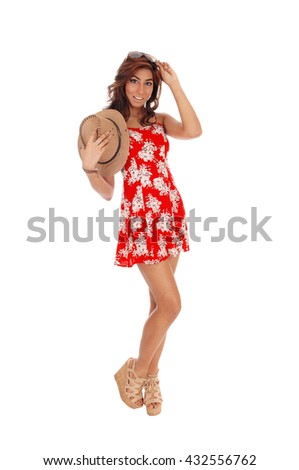 A pretty young woman in a red dress and curly brown hair holding