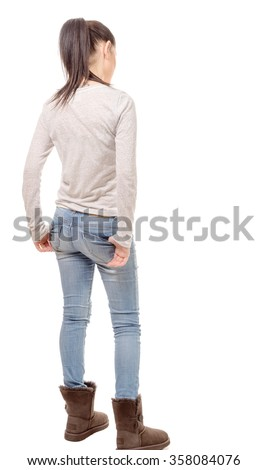 a pretty young woman standing on white background, back view - stock photo