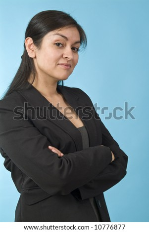 A pretty young woman with a bit of a smug or arrogant expression on her face. - stock photo