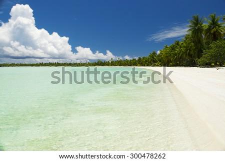 A pristine beach in atoll Anaa, French Polynesia - part of the Tuamotus  - stock photo